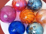 Blown-glass ornaments in a range of beautiful colors, from a husband and wife team in San Francisco. Lots of other pretty items in this store too! $25 each.Click here to purchase